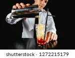 barman making cocktail at... | Shutterstock . vector #1272215179