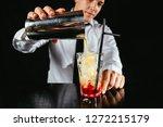 barman making cocktail at... | Shutterstock . vector #1272215179