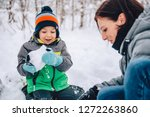 mother and son playing in the...   Shutterstock . vector #1272263860