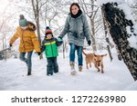 family with small yellow dog... | Shutterstock . vector #1272263980