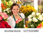 smiling florist flower shop... | Shutterstock . vector #127233380