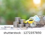 miniature yellow car model on... | Shutterstock . vector #1272357850