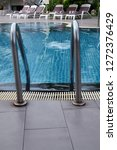 swimming pool in sunny day | Shutterstock . vector #1272376429