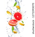 Small photo of Red grapefruits and yellow lemons in a splash of water. Grapefruit and lemon in motion. Tropical fruit concept.