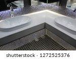 modern sinks with mirror in...   Shutterstock . vector #1272525376
