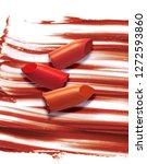 multicolored lipstick on... | Shutterstock . vector #1272593860
