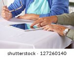 seniors using the internet with ... | Shutterstock . vector #127260140