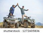 male riend riding atv vehicle... | Shutterstock . vector #1272605836