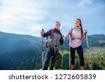 hikers with backpacks relaxing... | Shutterstock . vector #1272605839