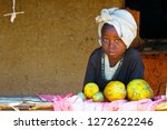 Stock photo poor african girl selling fruits madagascar 1272622246