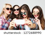 four happy teenage girls with... | Shutterstock . vector #1272688990