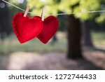 valentine's day card. two red... | Shutterstock . vector #1272744433