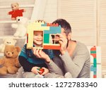 dad and kid with toys on wooden ... | Shutterstock . vector #1272783340