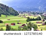 a small town nuzzled between... | Shutterstock . vector #1272785140