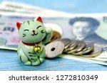 Stock photo maneki neko the lucky cat and japanese money 1272810349