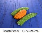 bitter melon on the board  | Shutterstock . vector #1272826096