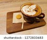 hot coffee macchiato latte art...   Shutterstock . vector #1272833683