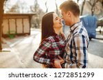 a young couple in colorful... | Shutterstock . vector #1272851299