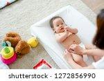baby having a change of diaper   Shutterstock . vector #1272856990