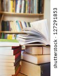 books on a table in library | Shutterstock . vector #127291853
