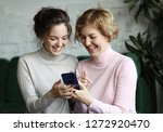 family  people and technology.... | Shutterstock . vector #1272920470