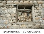 an old window in a village | Shutterstock . vector #1272922546