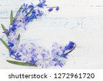 blue snowdrops on white wooden... | Shutterstock . vector #1272961720