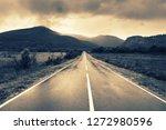 wet asphalt road in valley... | Shutterstock . vector #1272980596