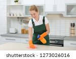 female janitor cleaning table... | Shutterstock . vector #1273026016