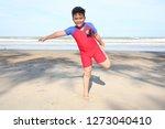 little boy excercising on the... | Shutterstock . vector #1273040410
