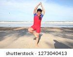 little boy excercising on the... | Shutterstock . vector #1273040413