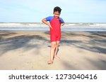 little boy excercising on the... | Shutterstock . vector #1273040416