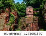 Dark Colorful View of Leshan Giant Buddha in Sichuan Province, China. Ancient Stone Sculpture Carving in Cliff Face.