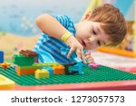 Child Playing And Building Wit...