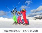 Girls with ski on the mountain - stock photo