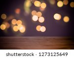 empty table on dark bokeh... | Shutterstock . vector #1273125649