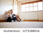 couple sitting on floor in... | Shutterstock . vector #1273188016
