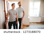 excited male couple opening... | Shutterstock . vector #1273188070