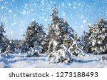 snowflakes falling from the sky.... | Shutterstock . vector #1273188493