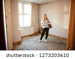 female first time buyer looking ... | Shutterstock . vector #1273203610