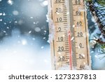 thermometer on snow shows low... | Shutterstock . vector #1273237813