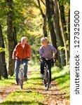 senior man and woman exercising ... | Shutterstock . vector #127325000
