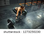 woman performs deadlift with... | Shutterstock . vector #1273250230
