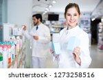 smiling female pharmacist is...   Shutterstock . vector #1273258516