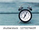 Retro Alarm Clock On Green...