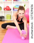 young woman doing fitness... | Shutterstock . vector #127329656