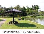 vintage wood shelter in public...   Shutterstock . vector #1273342333