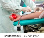 blood donor at donation with a... | Shutterstock . vector #127341914