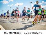 marathon runners in the city  | Shutterstock . vector #1273450249