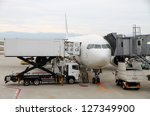 Commercial airplane parked at the airport - stock photo